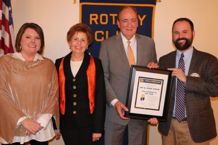 Club President Chris Warren (far right) and Citizen of the Year Committee Chair Martee Moseley (far left) present Jay an
